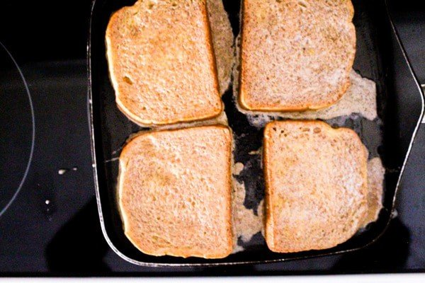 french toast slices cooking on a griddle