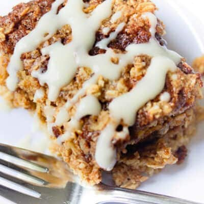 slice of cinnamon roll baked oatmeal with cream cheese glaze