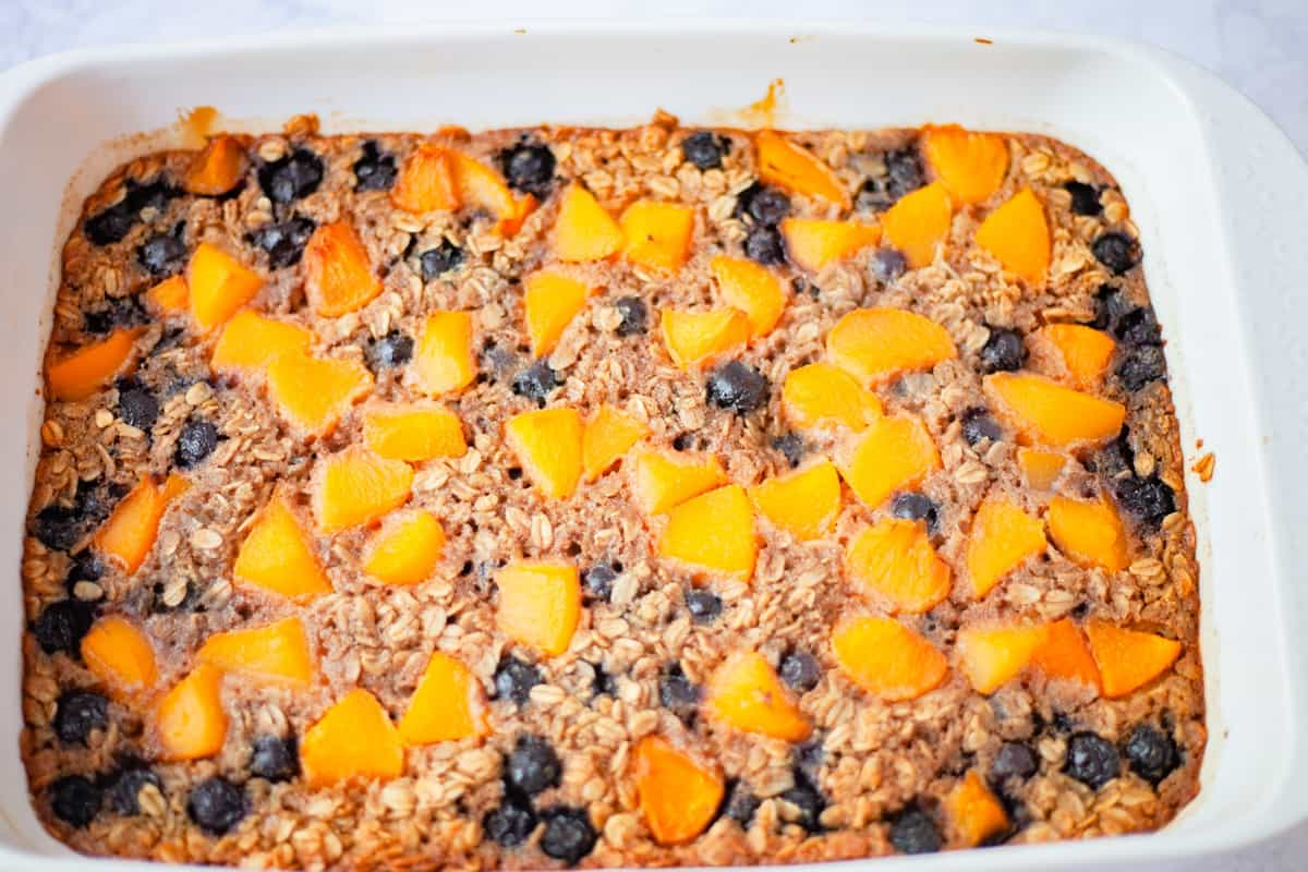 a full baking dish of peach berry baked oatmeal