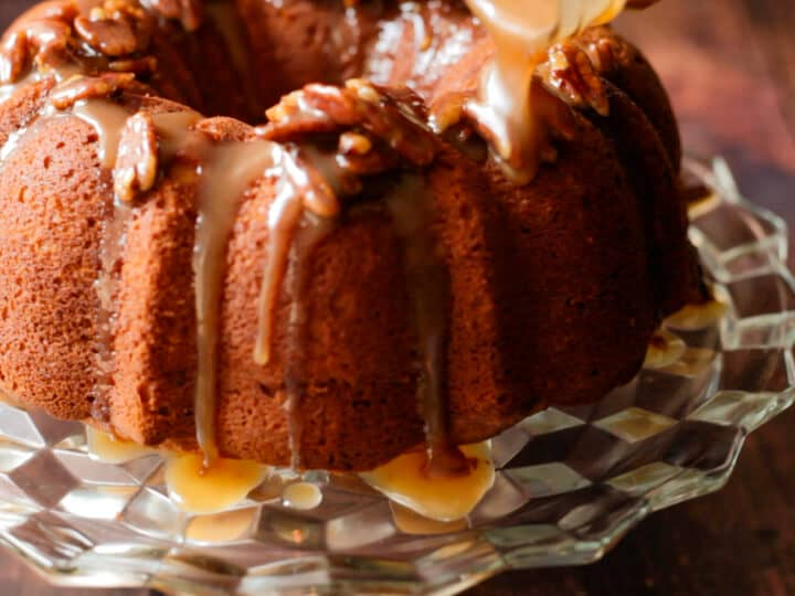 pouring praline sauce over sweet potato pound cake