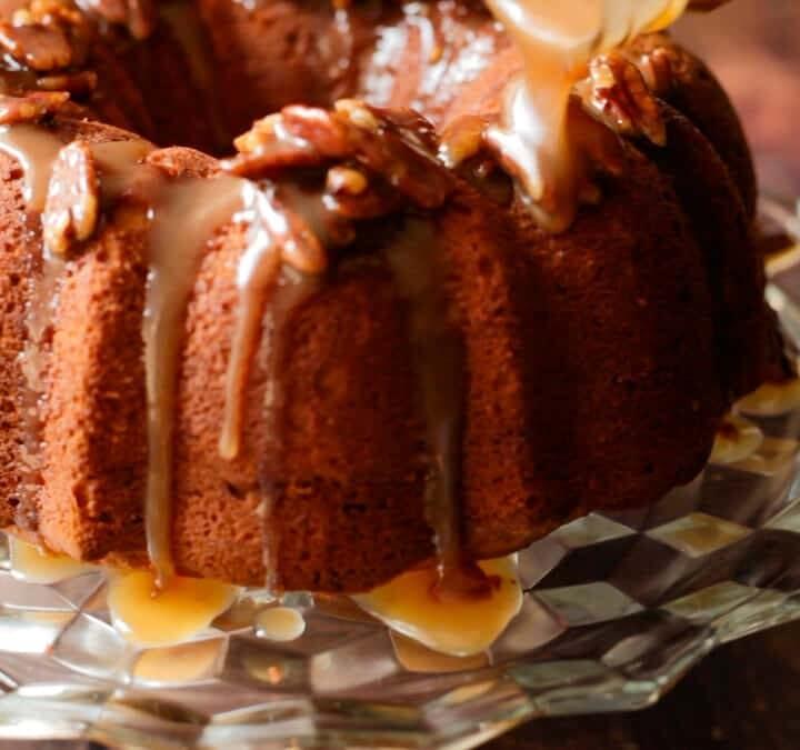 pouring praline sauce over sweet potato pound cake