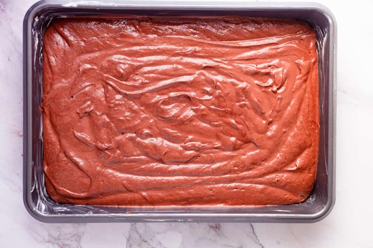 chocolate cake batter in a sheet pan