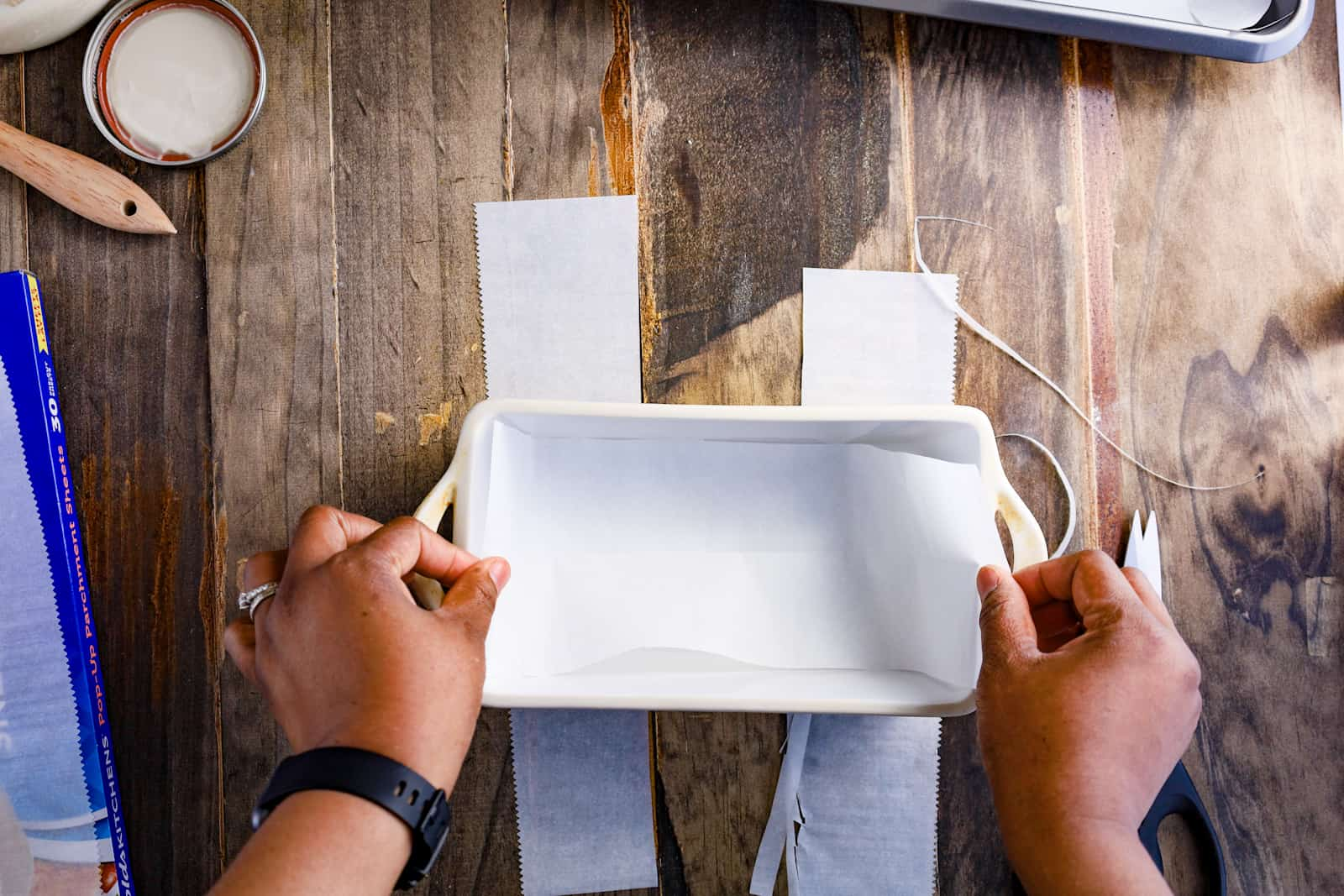 lining a loaf pan with parchment