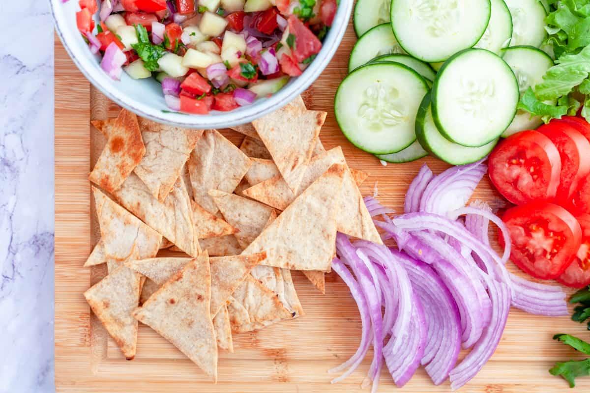 Mediterranean Greek salsa on a platter with sliced vegetables