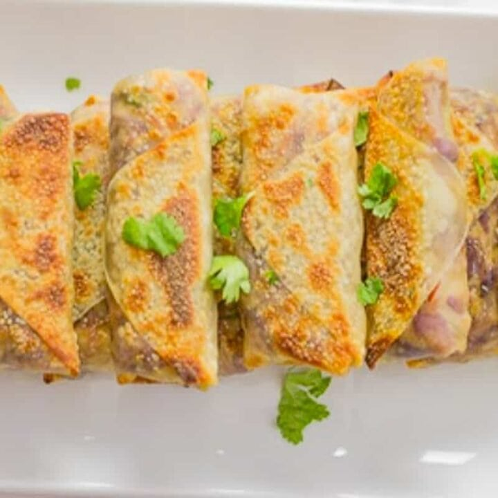 a plate of baked chicken egg rolls