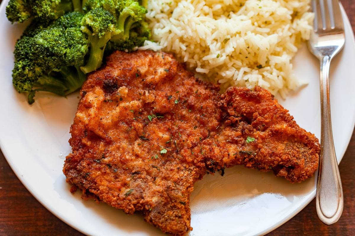 southern fried pork chop on a plate close up