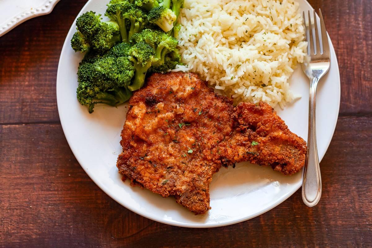 southern fried pork chop on a plate