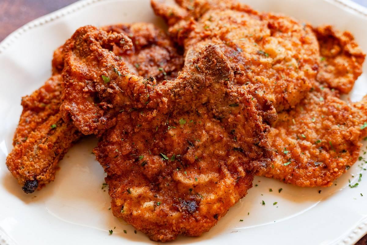 fried pork chops on a plate
