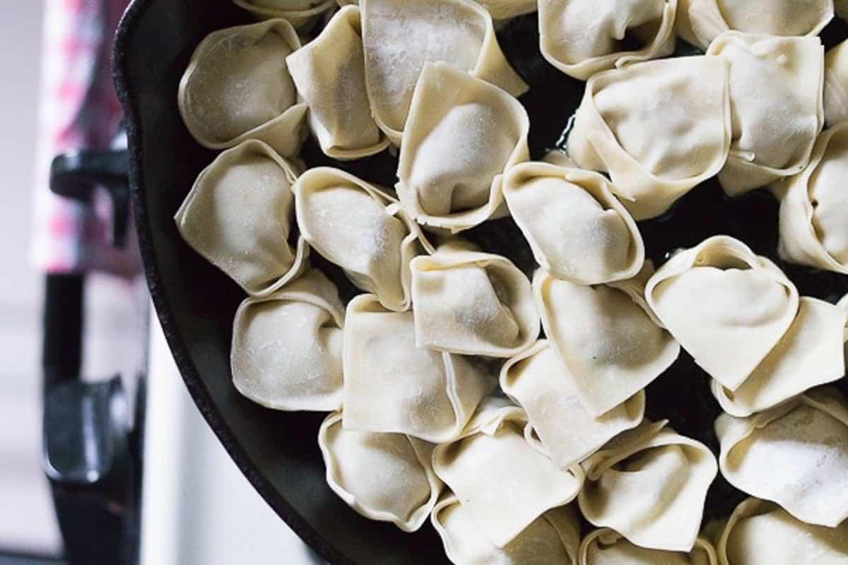 dumplings lined in a skillet