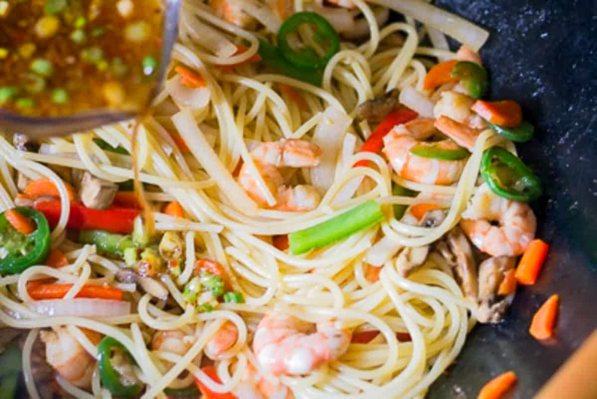 spaghetti noodles with vegetables in a wok