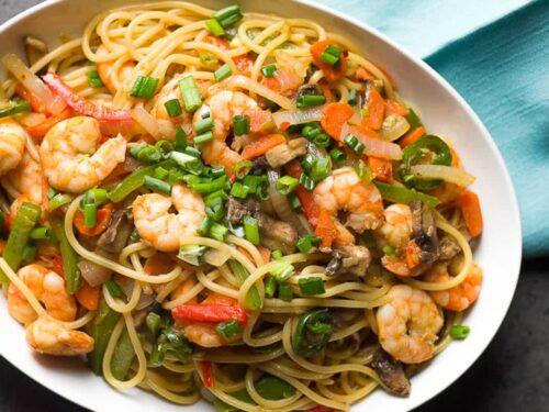a bowl of shrimp lo mein