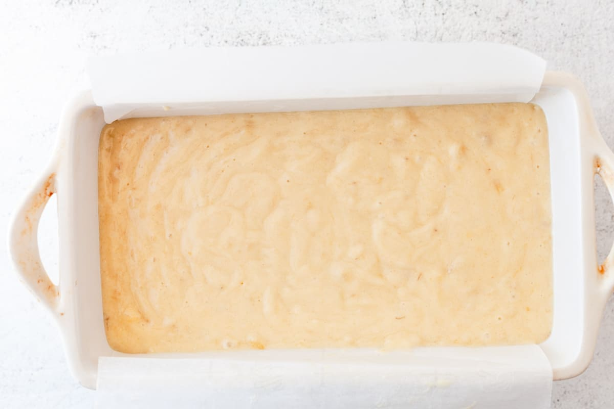banana bread batter in a loaf pan