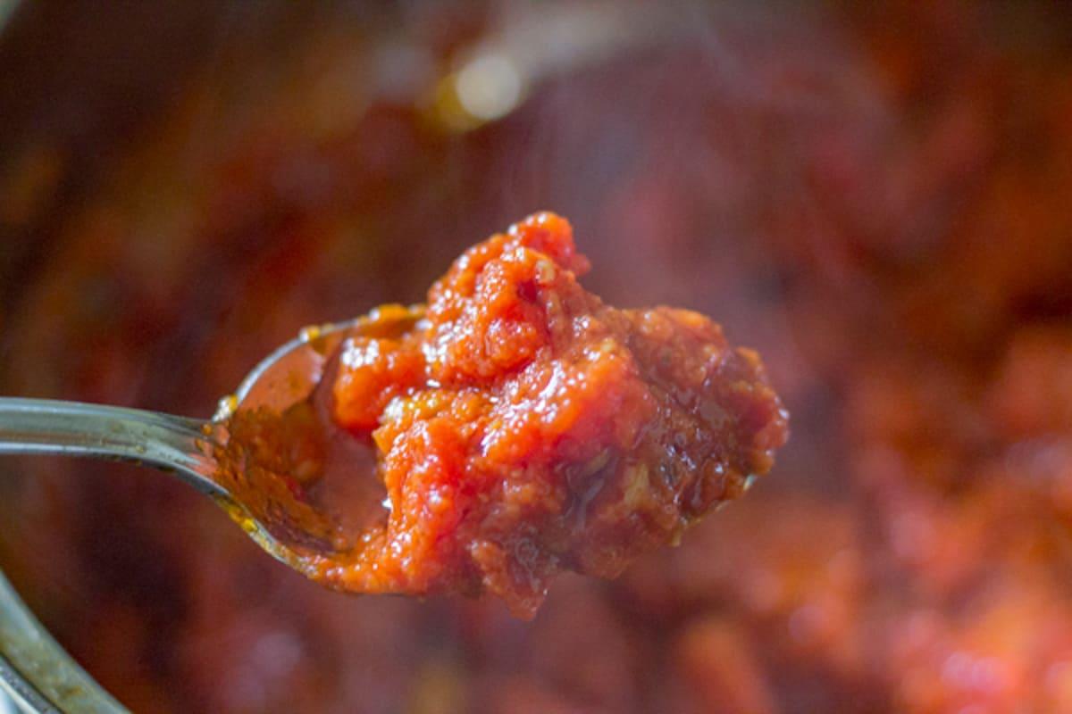 chunky marinara sauce on a spoon