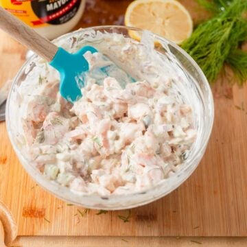 maryland shrimp salad in a bowl with a rubber spatula