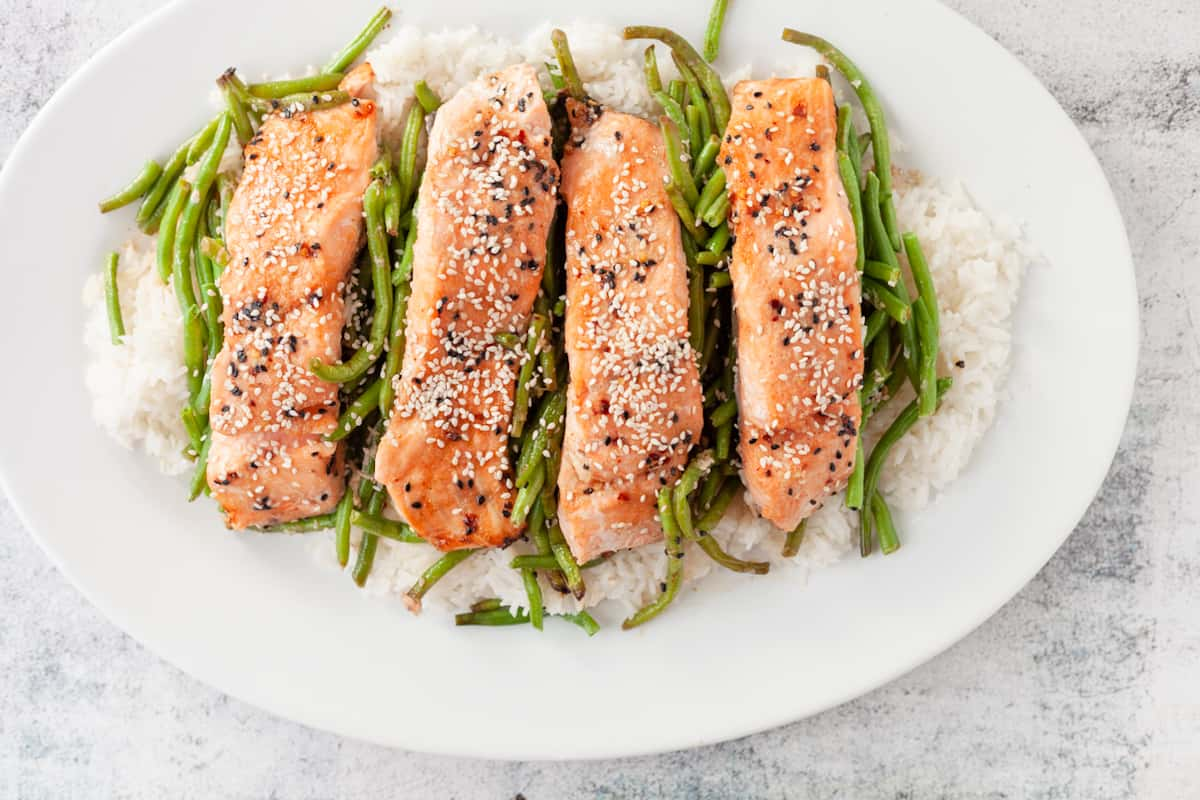 plated salmon with green beans over rice