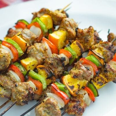 grilled pork tenderloin kabobs on a white plate