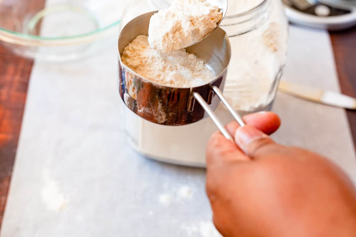 spooning flour into a measure cup