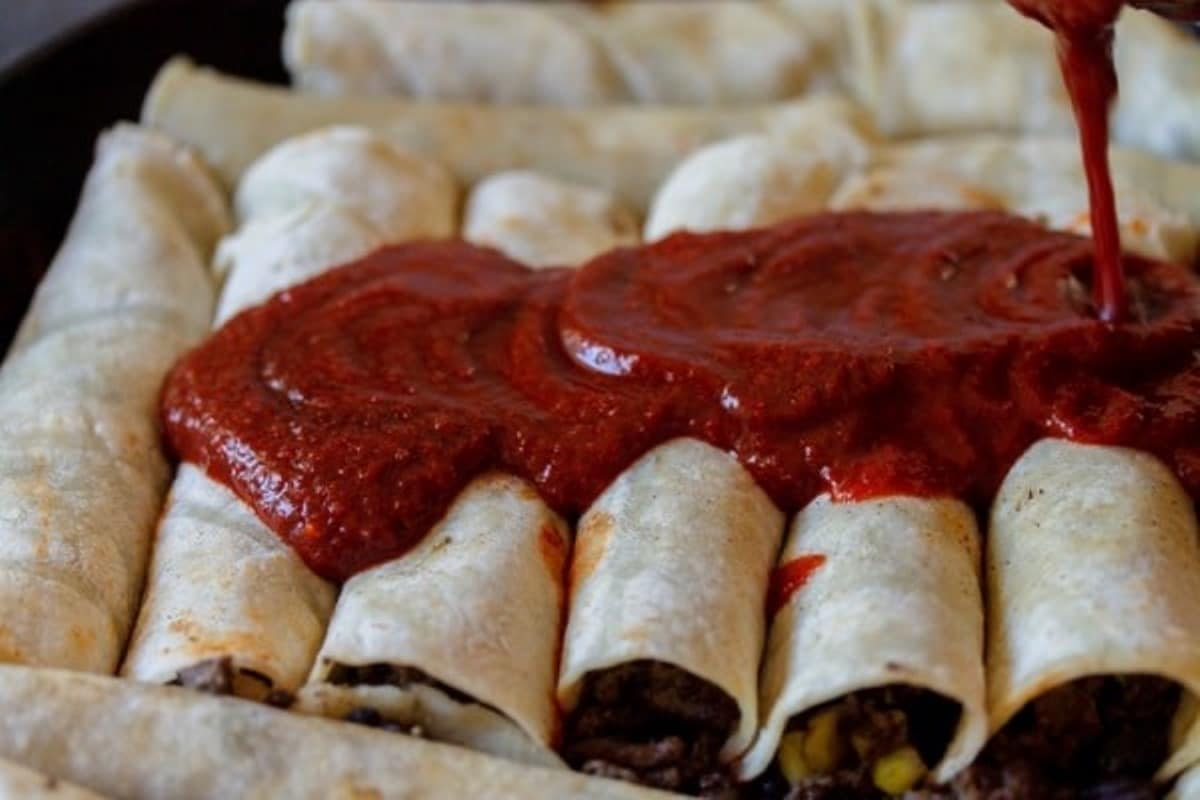 tortillas covered with enchilada sauce
