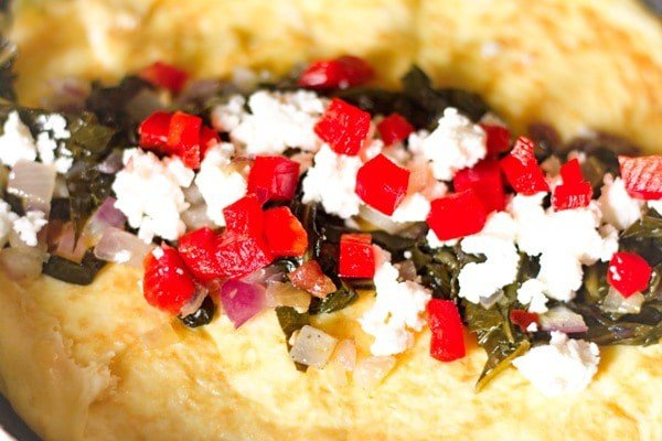 red peppers and feta inside of a collard green omelet