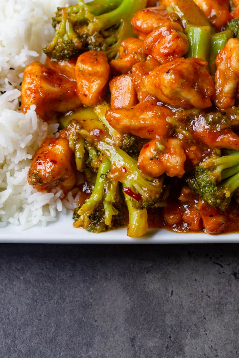 sweet chili chicken with rice on a plate