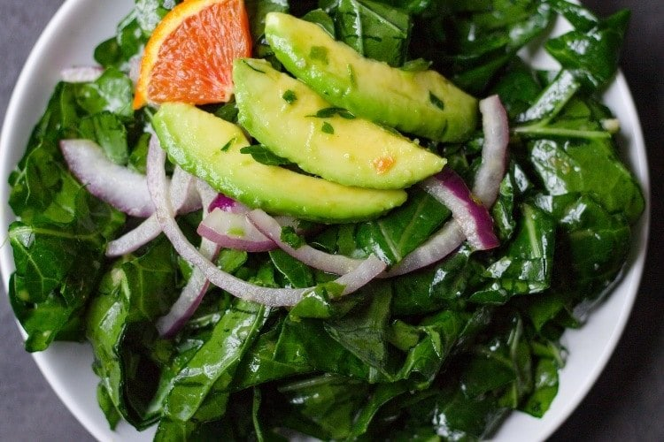 collard greens salad on a plate with dressing