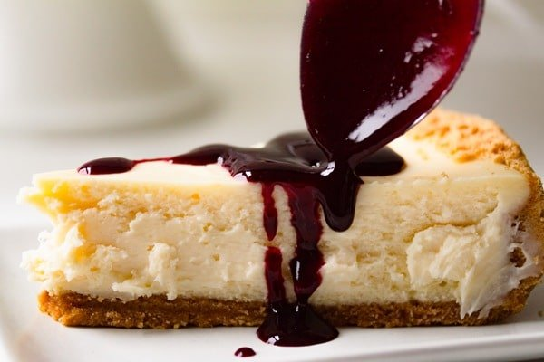 coulis poured over crack-proof New York cheesecake