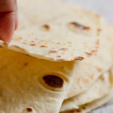 soft and flexible flour tortillas being folded