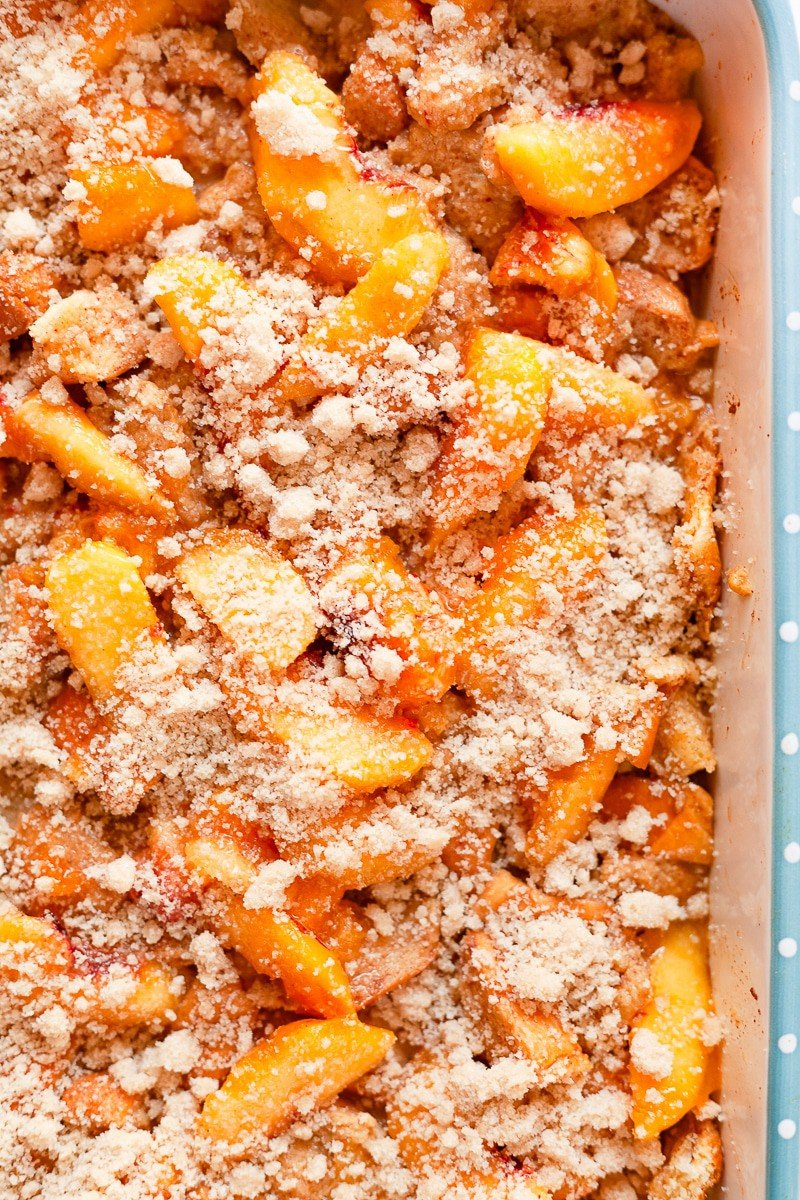 peach cobbler french toast casserole in a 9x13 baking dish