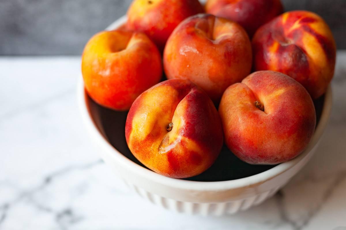 fresh peaches in a bowl