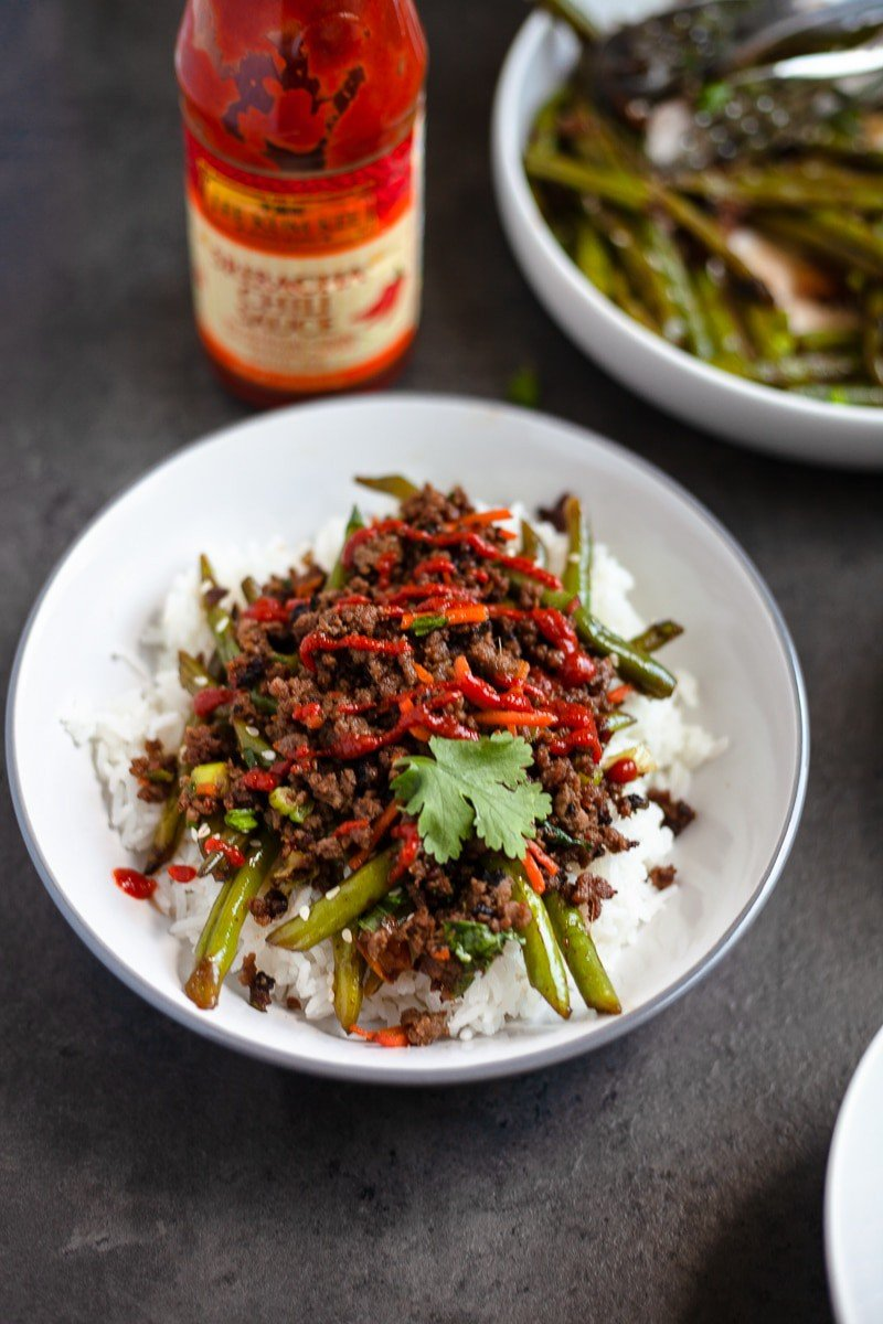 asian beef bowl over green beans and rice
