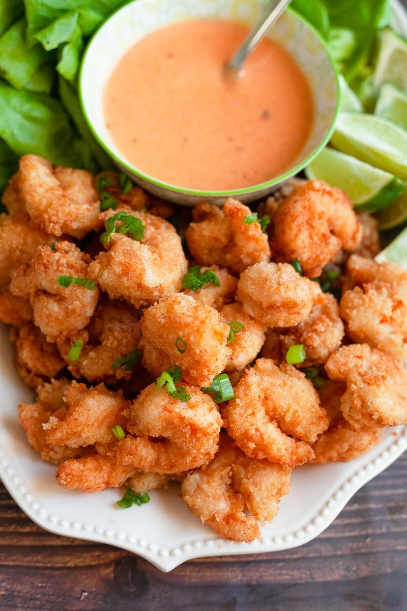 buttermilk fried shrimp with bang bang sauce in a platter
