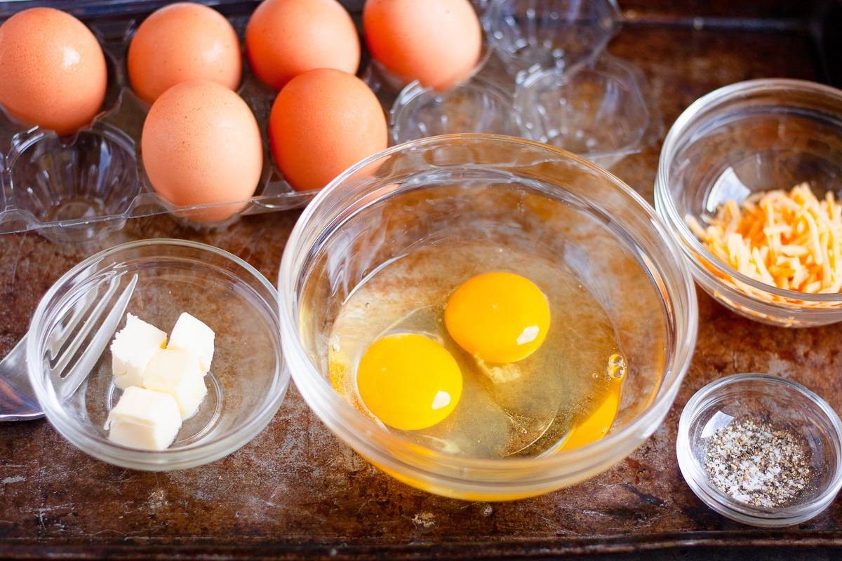 eggs, cheese, and butter in glass bowls