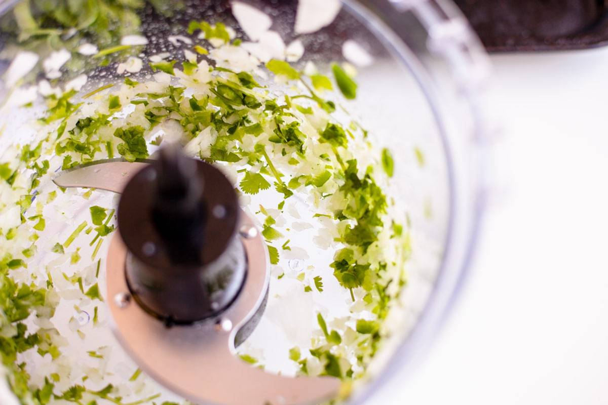 jalapeno and onion in a food processor