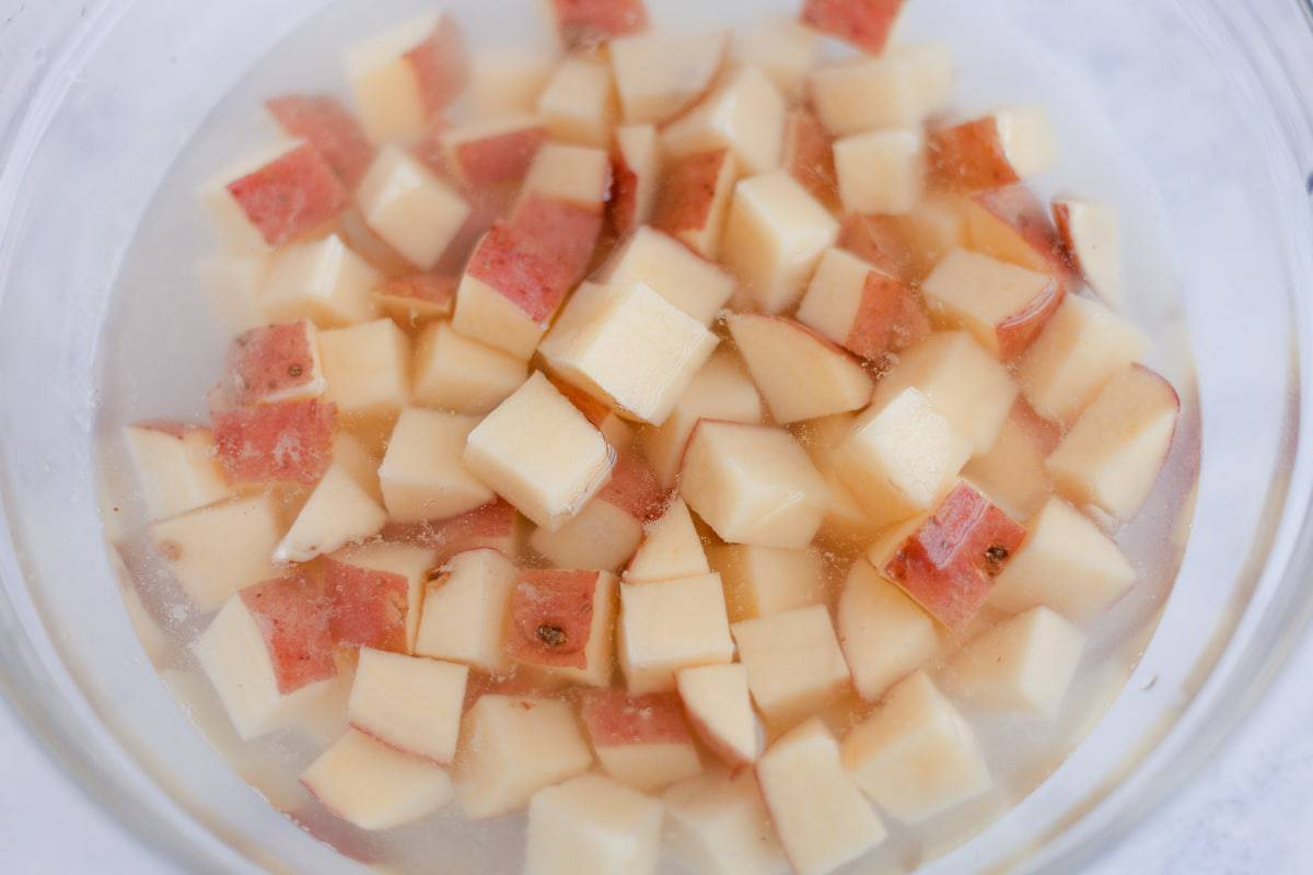 diced red potatoes in water