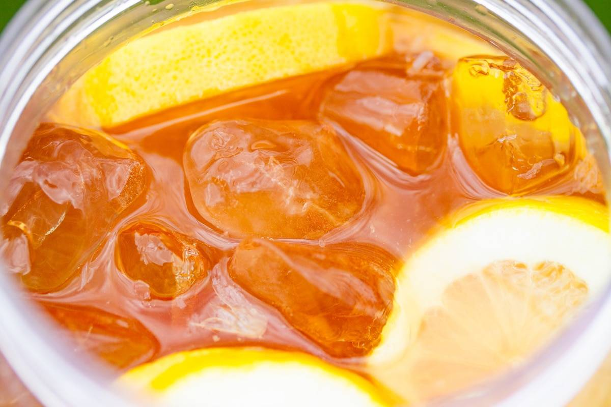 lemon slices in iced tea close up