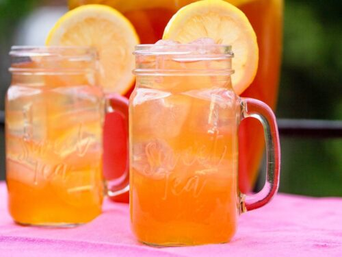 glasses filled with lemonade iced tea and lemon slices