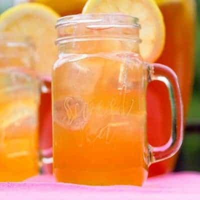 glasses filled with lemonade iced tea and lemon slices