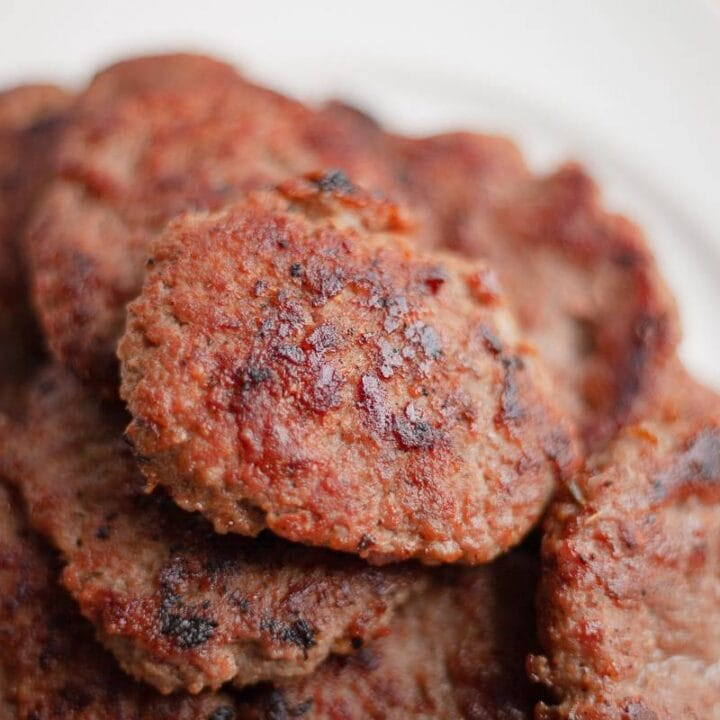 low carb sausage patties on a plate close up