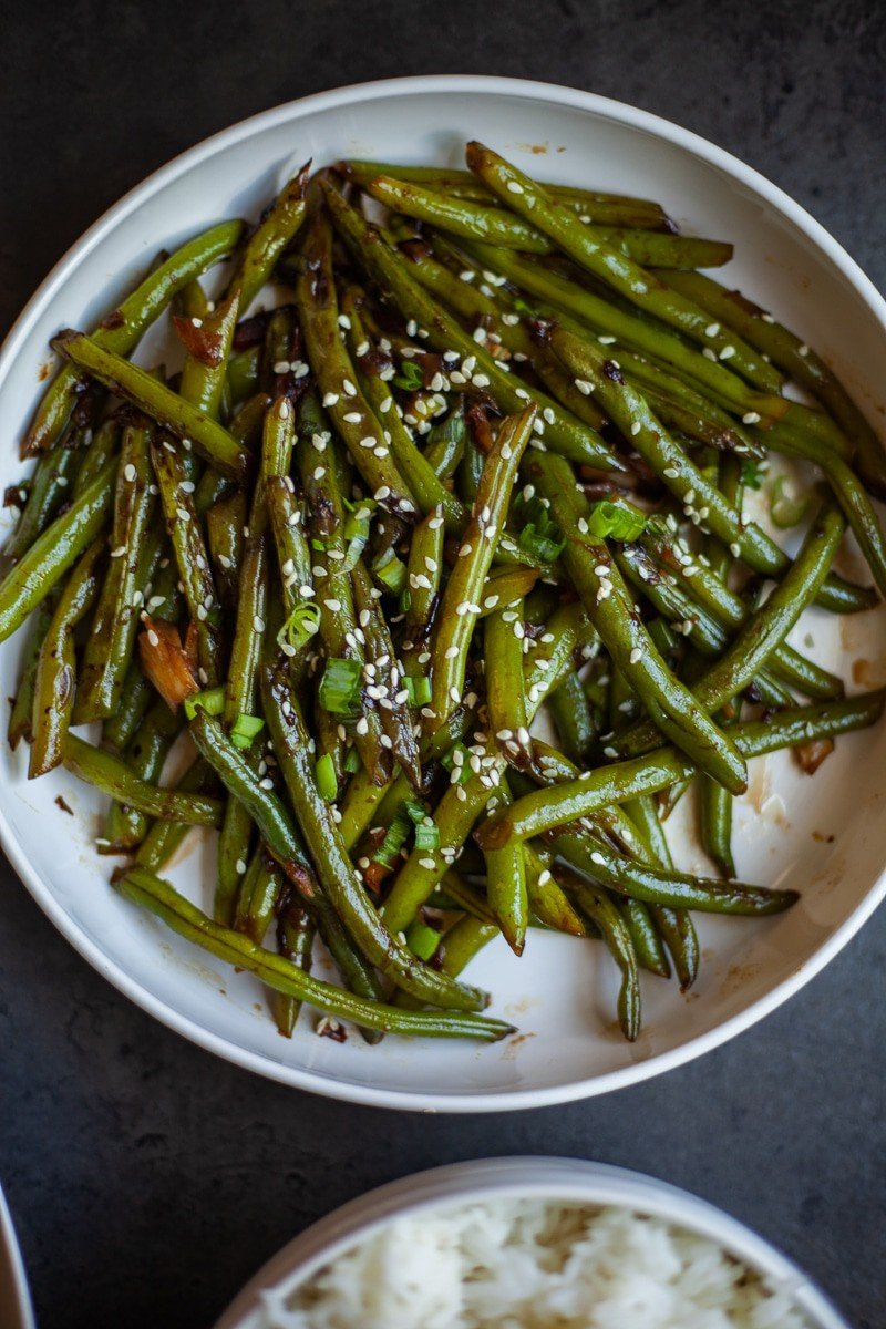 a plate of cooked garlic green beans
