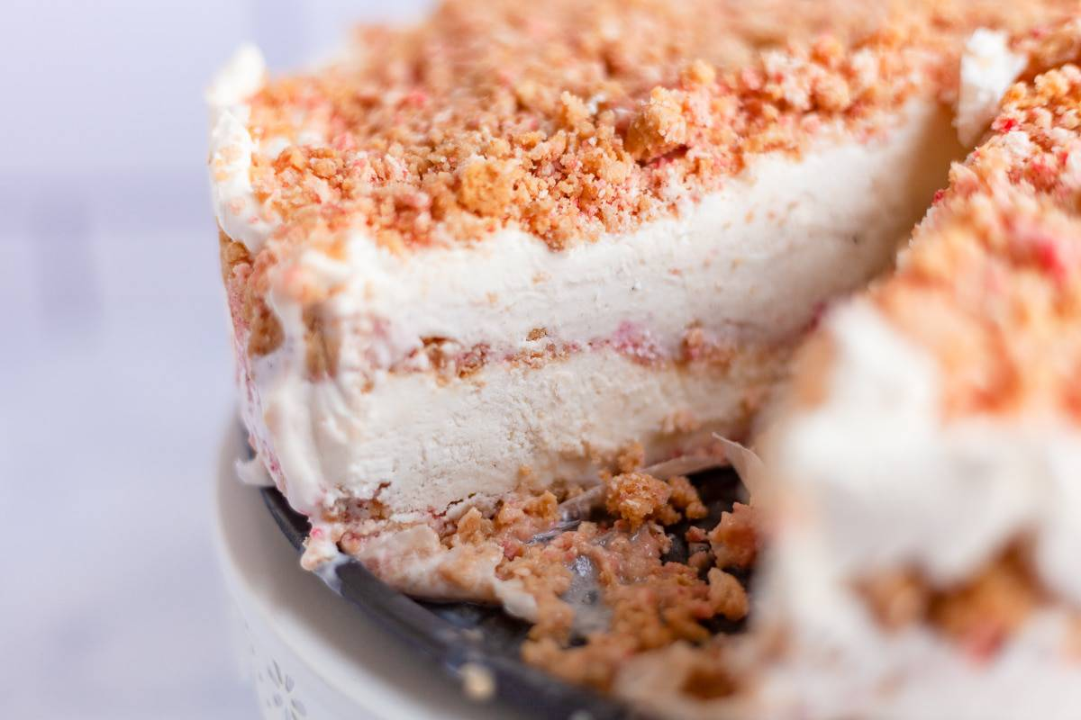 strawberry crunch ice cream cake with a slice removed