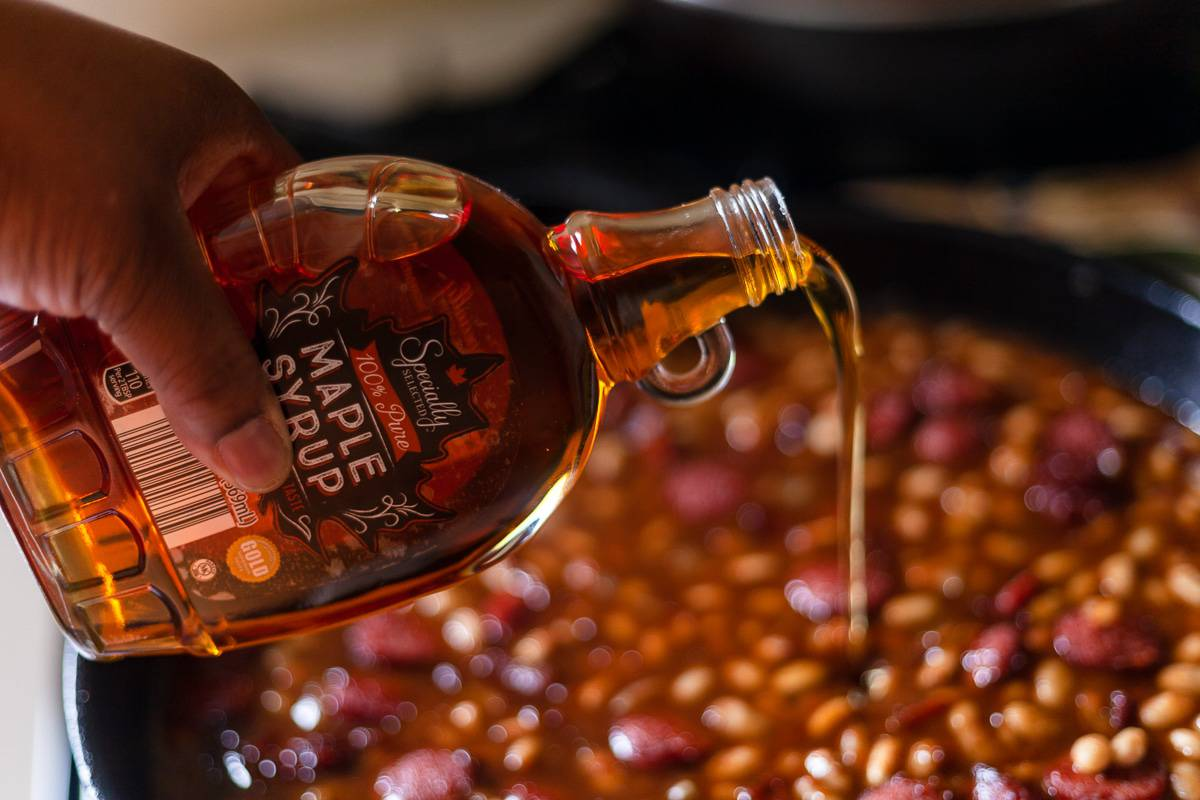 maple syrup poured into baked beans