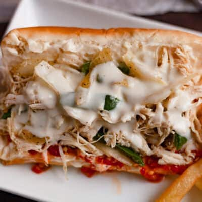 chicken cheesesteak with sauce on a plate