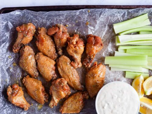 crispy lemon pepper wings on a tray