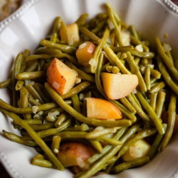green beans and potatoes in a bowl close up