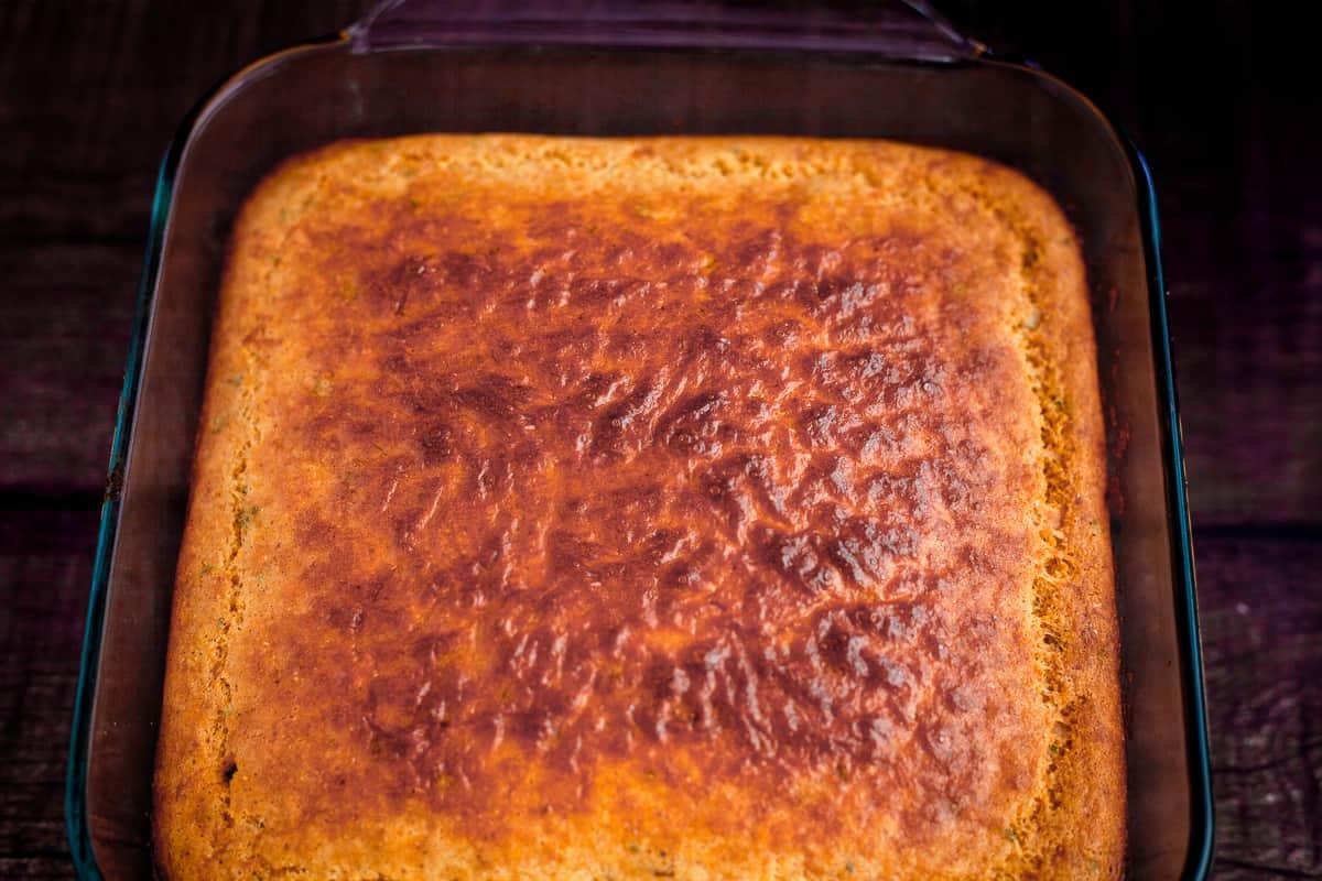 parmesan cornbread in a baking dish