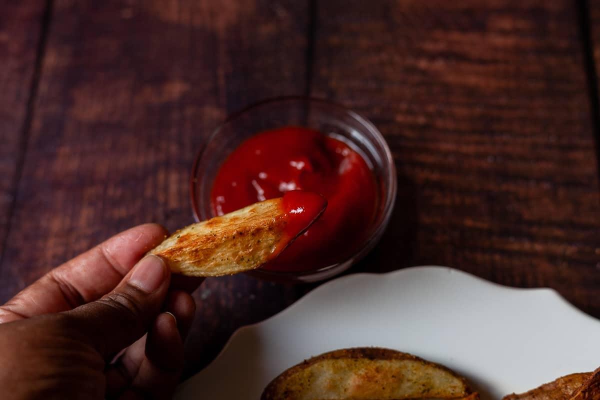 ketchup dipped potato wedge