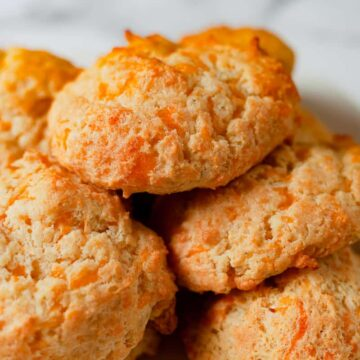 cheddar drop biscuits on a plate close up