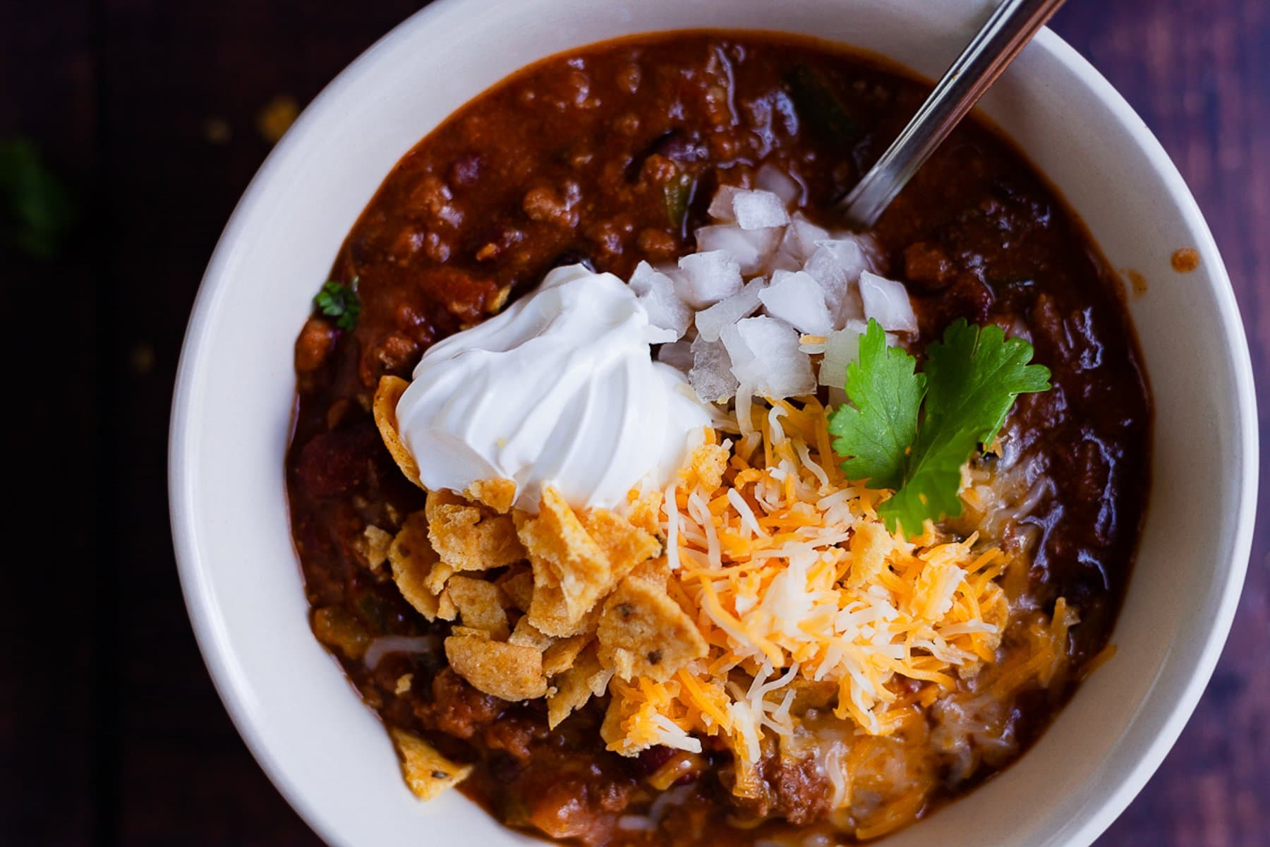 stovetop chili with toppings close up