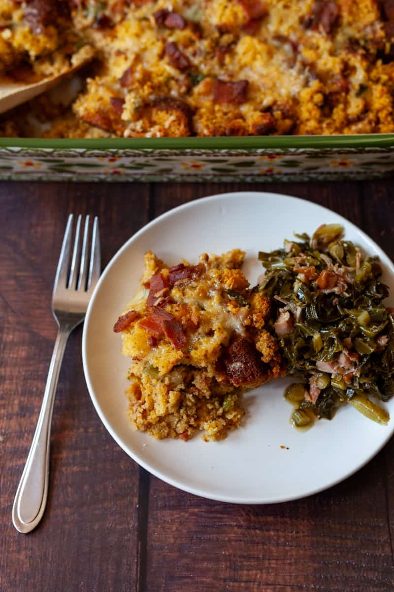 bacon cornbread stuffing plated with collard greens