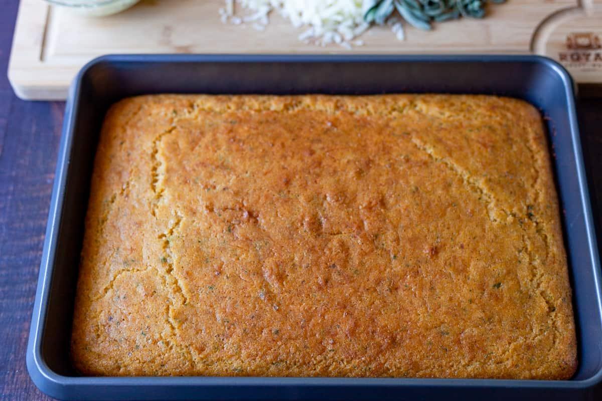 savory parmesan cornbread in a pan